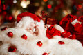 Christmas newborn baby sleeping in Santa hat Royalty Free Stock Photo