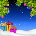 Christmas night background with gifts and decorations Royalty Free Stock Image