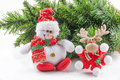 Christmas objects tree with ornaments a doll and a reindeer Stock Photos