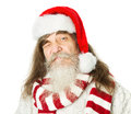 Christmas old man with beard in red hat santa claus funny parody over white background Stock Photos