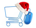 Christmas online shopping concept santa hat sitting on a cart formed by a mouse cable Royalty Free Stock Images