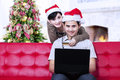 Christmas online shopping at home couple doing during Royalty Free Stock Images