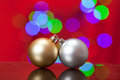 Christmas ornament close up of a silver and gold with lights in the background Royalty Free Stock Photos