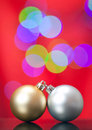 Christmas ornament close up of a silver and gold with lights in the background Royalty Free Stock Image