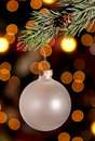 A christmas ornament hanging from a pine branch Royalty Free Stock Photos