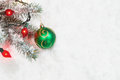 Christmas Ornament with Lights hanging from Tree Branch Royalty Free Stock Photo
