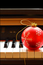 Christmas ornament on piano Royalty Free Stock Photo