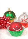 Christmas ornaments in cupcake liners Royalty Free Stock Images