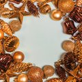 Christmas ornaments decorative border. Xmas background with golden retro decorations and place for text. Fir tree toys Royalty Free Stock Photo