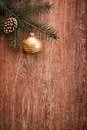 Christmas ornaments and fir tree branch on a rustic wooden background Royalty Free Stock Photo