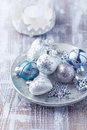 Christmas ornaments glass on a silver plate Royalty Free Stock Images
