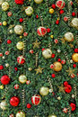 Christmas ornaments in greenery background red and gold glass ball spirals and stars fir tree Stock Photography