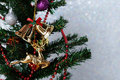 Christmas ornaments hanging on christmas tree over white giltter Royalty Free Stock Photo