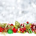 Christmas ornaments in snow with twinkling background
