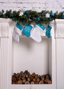 Christmas ornaments and socks on the white mantel Royalty Free Stock Photography