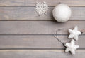 Christmas ornaments in white on a light gray wooden background.  New Year`s accessories. View from above. Royalty Free Stock Photo