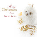 Christmas owl and decoration on a white snow with easy removable sample text Royalty Free Stock Images