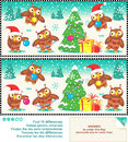 Christmas owls find the differences picture puzzle or new year visual ten between two pictures trimming tree answer Stock Photo
