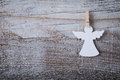 Christmas paper angel decoration over wooden background