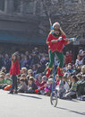 Christmas parade juggler on a unicycle asheville north carolina usa november colorful dressed like an elf rides entertains kids Stock Photo