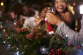 Picture : Christmas party at a bar, focus on foreground decorations with
