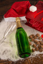 Christmas party still life around a bottle of champagne Royalty Free Stock Image