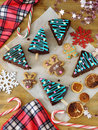 Christmas pastry, candies and decorations. Cakes decorated as Christmas trees Royalty Free Stock Photo