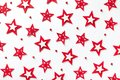 Christmas pattern of red stars on a white wooden background. Royalty Free Stock Photo