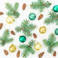 Christmas pattern of winter trees, pine cones and Christmas balls on white background. New year composition. Flat lay, top view Royalty Free Stock Photo