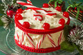 Christmas peppermint drum cake with spoons for drumsticks a tasty holiday treat Royalty Free Stock Photography