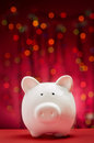 Christmas piggy bank with lights background Royalty Free Stock Photo
