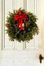 Christmas Pine Wreath with Red Bow on Antique Door Stock Photo