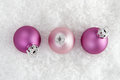 Christmas pink balls on artificial snow with white background Stock Photography