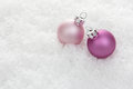 Christmas pink balls on artificial snow with white background Royalty Free Stock Photos