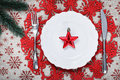 Christmas plate on holiday background with red star Royalty Free Stock Photo
