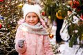 Christmas portrait of happy child girl holding burning sparkler or firework outdoor Royalty Free Stock Photo