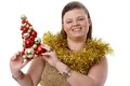 Christmas portrait of plump woman smiling happy holding small tree Stock Photography