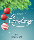 Christmas postcard. Merry Christmas background with fir tree branch and Christmas decorations, hanging balls.