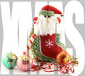 Christmas poster with santa claus in a sock and ornaments around word xmas superimposed on the image Stock Image