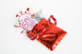 Christmas present advent calendar small bag with money on white abckground Royalty Free Stock Photo