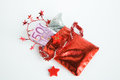 Christmas present advent calendar small bag with money on white background Royalty Free Stock Images