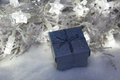 Christmas present box in snow with star lights Royalty Free Stock Photo