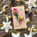 Christmas present on a wooden background with gold and candy Royalty Free Stock Photo