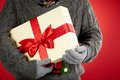 Christmas present image of giftbox in gloved male hands Stock Image