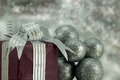 Christmas Present with Silver Glitter Baubles. Royalty Free Stock Photography