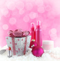 Christmas presents beauty products with snow and pink background Stock Images