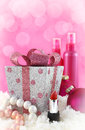 Christmas presents beauty products with snow and pink background Stock Photo