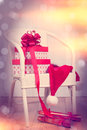 Christmas presents on chair with vintage feel and bokeh background Royalty Free Stock Photos