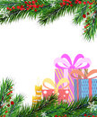 Christmas presents and christmas tree fir branches on white background Stock Image