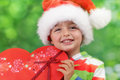 Christmas presents excitement ecstatic young boy on morning holding a present Stock Images